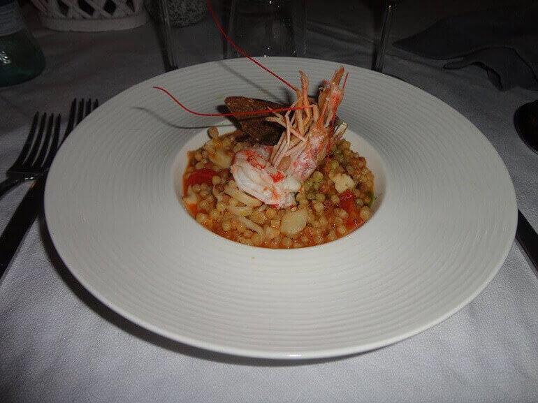 La fregula con zuppa di pesce di Cascina Ovi
